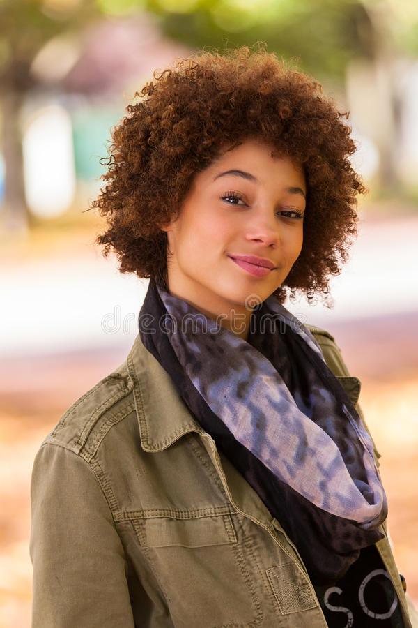 Autumn outdoor portrait of beautiful African American young woman - Black people stock photo