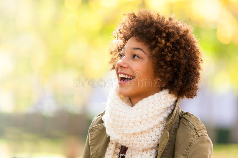 Autumn outdoor portrait of beautiful African American young woman - Black people stock images