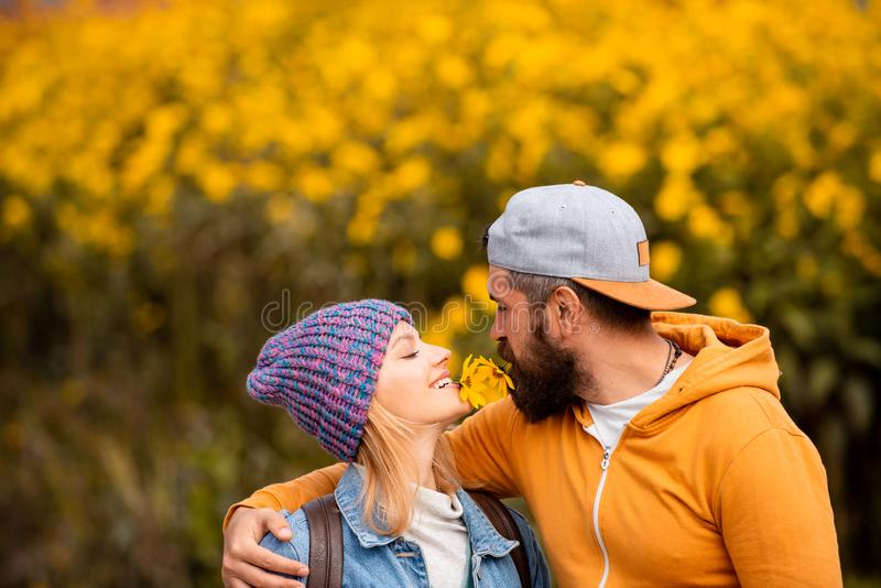 Autumn outdoor portrait of beautiful happy girl and bearded man walking in park or forest. Outdoor autumn portrait royalty free stock images