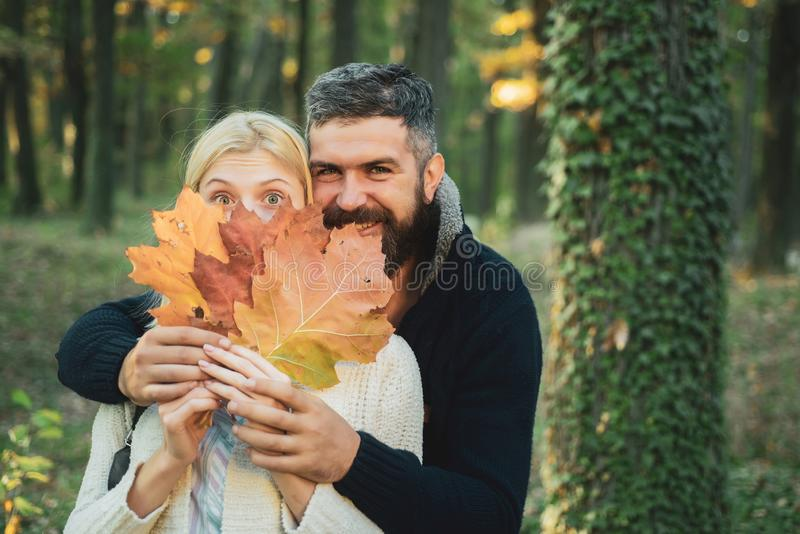 Autumn outdoor portrait of beautiful happy girl and bearded man walking in park or forest. Fashion autumn portrait woman stock photo