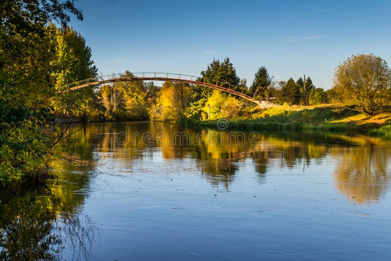 Autumn over the river, city of Bydgoszcz, Poland. Brda River in the city of Bydgoszcz, Poland in autumn colors royalty free stock photography
