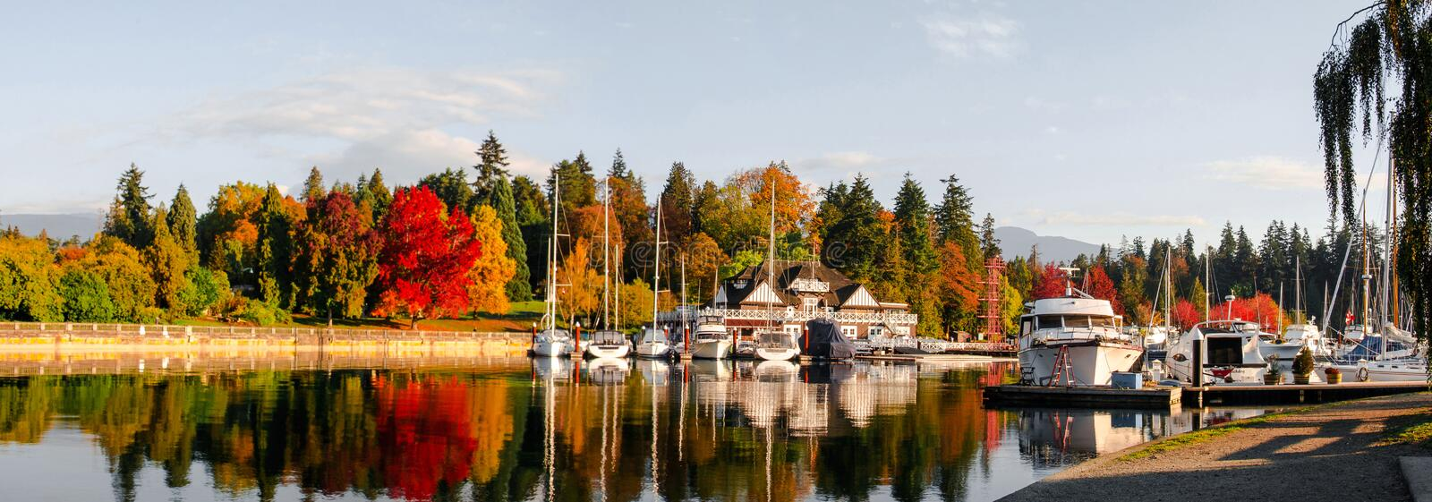 Autumn panoramic view of Vancouver skyline as seen from Stanley Park, British Columbia, Canada royalty free stock photography