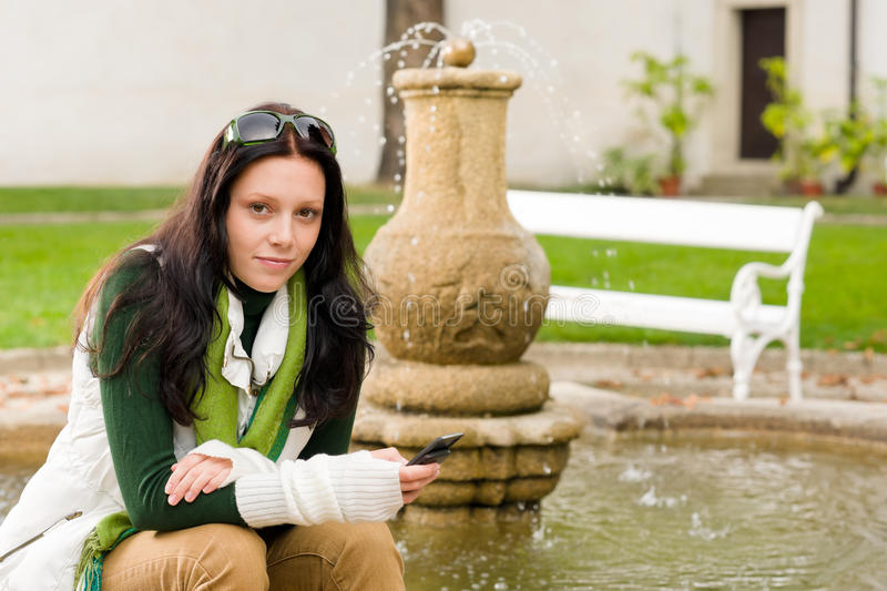 Download Autumn Park Fountain Young Woman Hold Phone Stock Photo - Image: 23707742