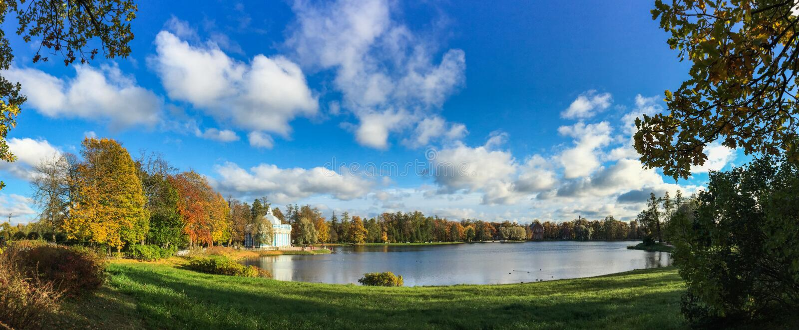 Autumn park in St. Petersburg, Russia. Autumn park with the lake at sunny day in St. Petersburg, Russia stock images