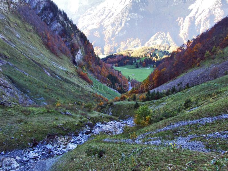 Autumn pastures and farms in the valley of lake Klontalersee or in the Klontal valley. Canton of Glarus, Switzerland royalty free stock image