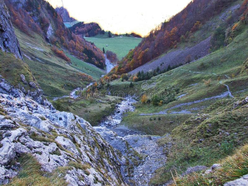 Autumn pastures and farms in the valley of lake Klontalersee or in the Klontal valley. Canton of Glarus, Switzerland royalty free stock photo