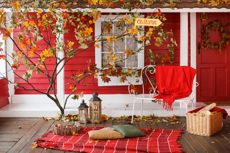 Autumn picnic on the veranda of a country house. Tree with yellow foliage in the backyard stock photos