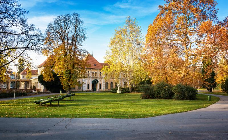 Autumn in Piestany Slovakia – park, historical building, col. Orful trees, blue sky stock images