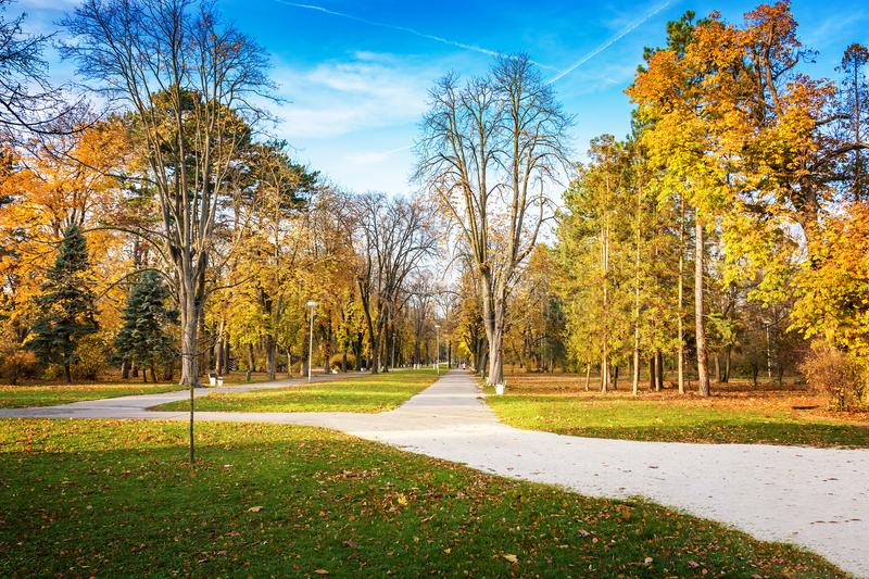 Autumn in Piestany Slovakia – park, historical building, col. Orful trees, blue sky royalty free stock photography