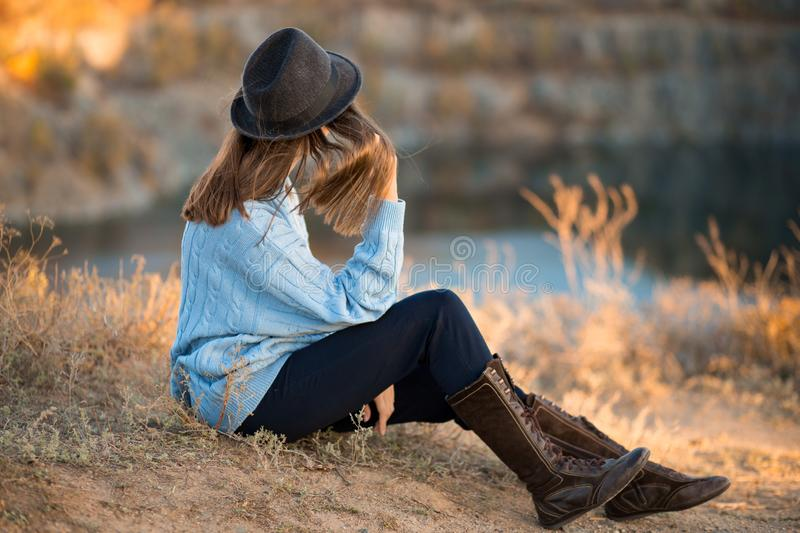 Autumn portrait of beautiful girl in black hat and blue sweater stock photo