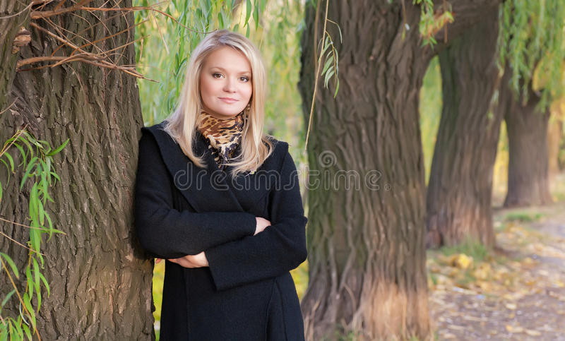 Autumn portrait of blonde girl royalty free stock photography