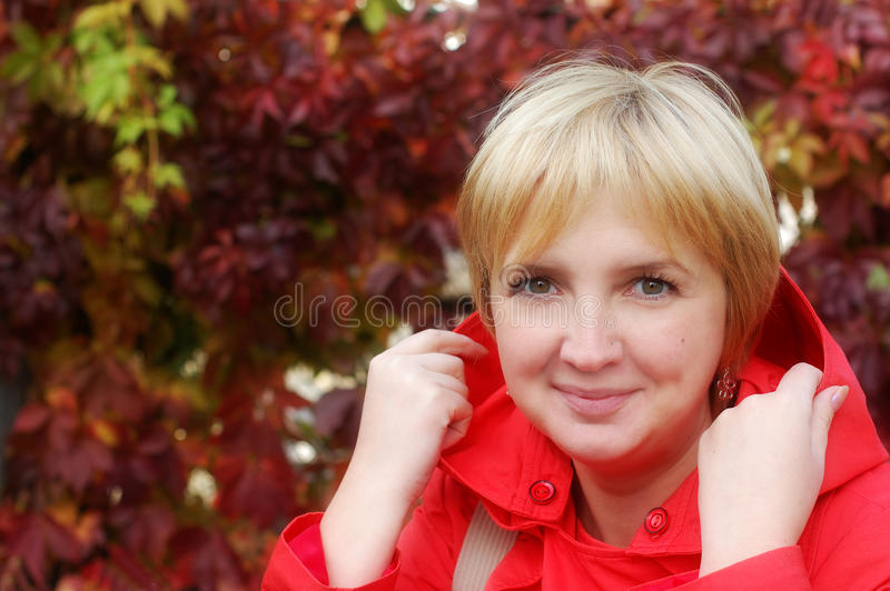 Autumn portrait of blonde woman stock photo