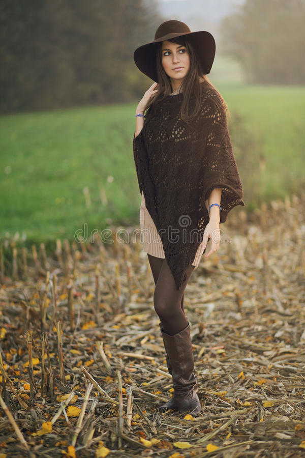 Autumn portrait of a girl posing in a field. Seasonal colors royalty free stock images
