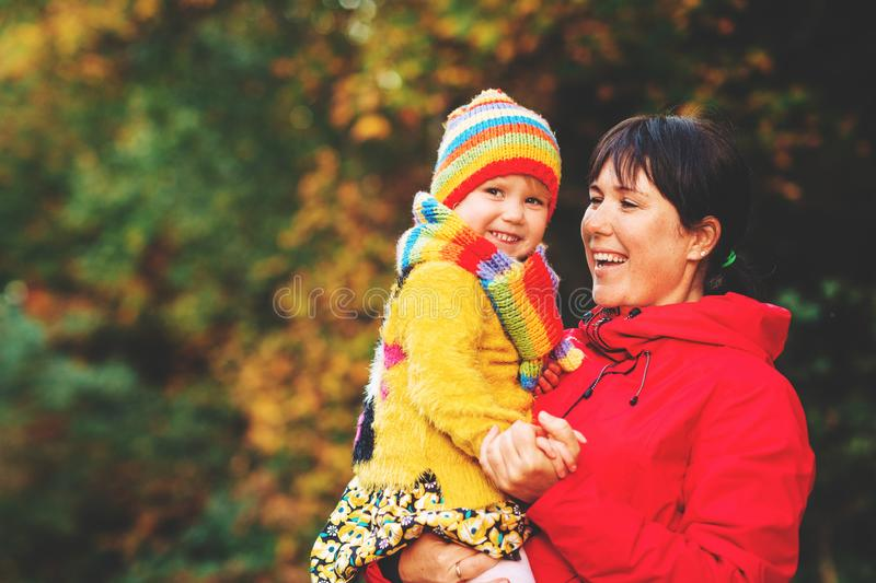 Autumn portrait of happy young mother holding cute little daughter royalty free stock image