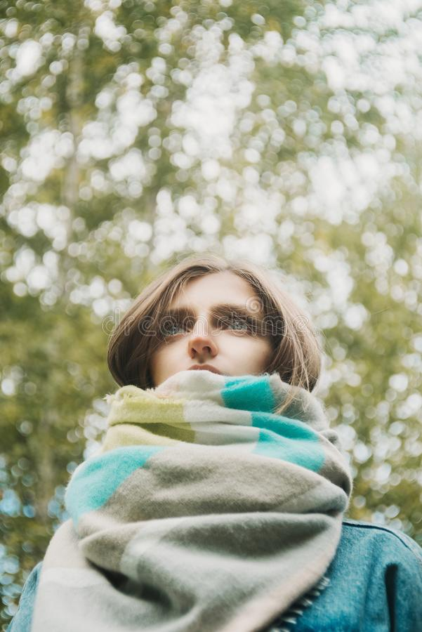 Autumn portrait of young adult woman wrapped in scarf royalty free stock photos