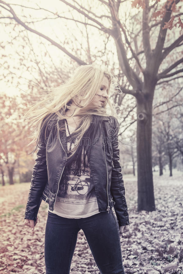 Autumn portrait of a young blond woman stock images