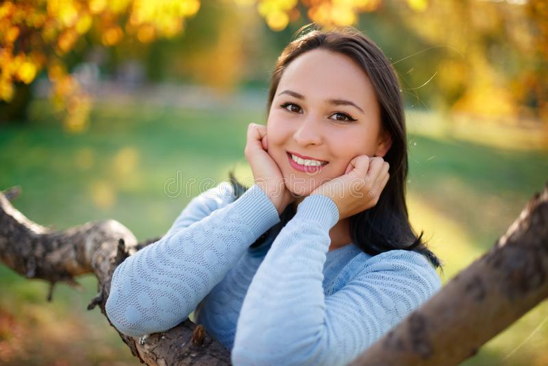 Autumn portrait of a young happy woman girl with autumn Sunny Park royalty free stock image
