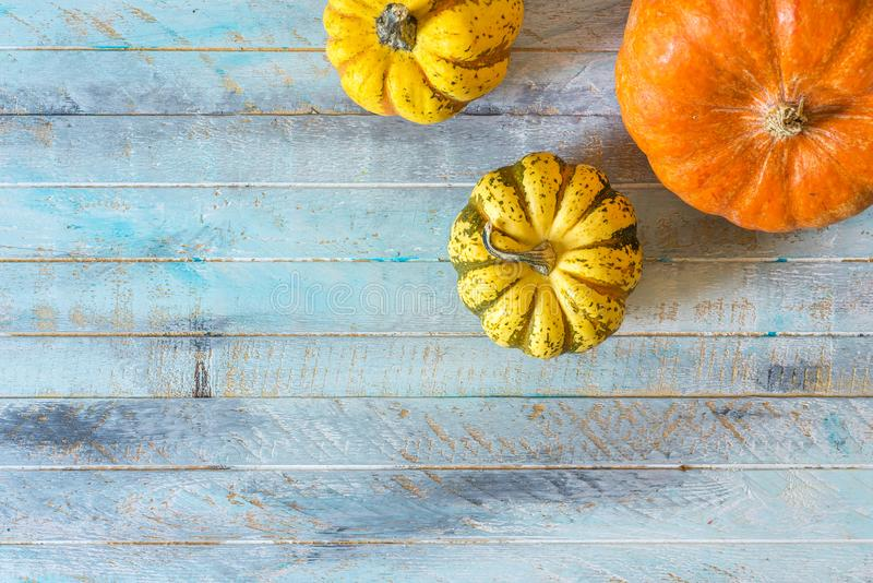 Autumn pumpkin Thanksgiving background. Over wooden table, flat lay, top view stock image