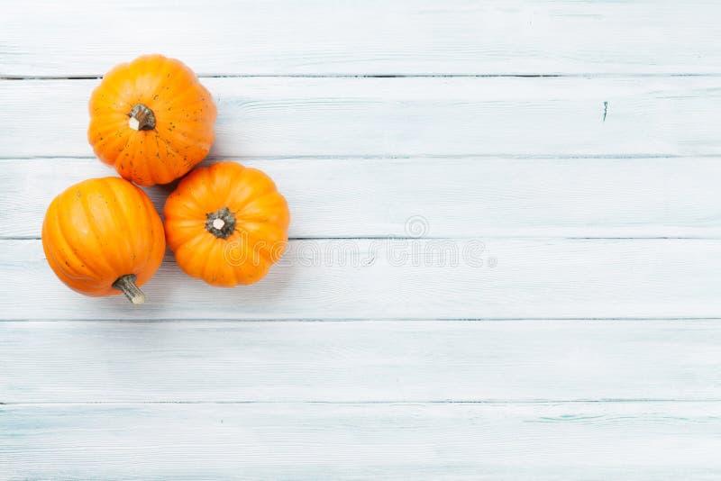 Autumn pumpkins on wooden table stock photos