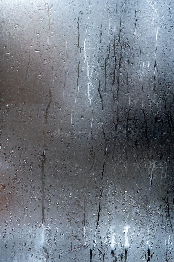 Autumn rain, the inscription on the sweaty glass - question mark vertical insta. Autumn rain, the inscription on the sweaty glass - question mark royalty free stock images
