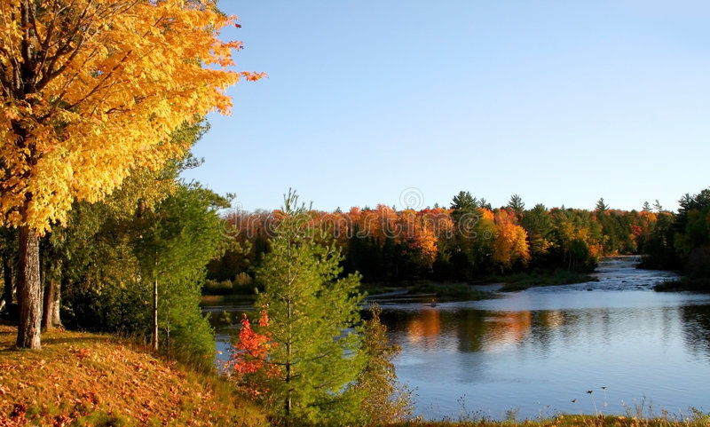 Autumn Reflections. Autumn landscape Colorful trees in mountains of Michigan stock photo