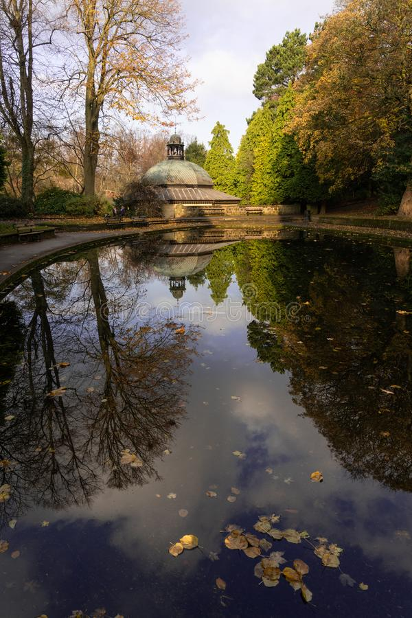 Autumn reflections on a boating pond. stock images