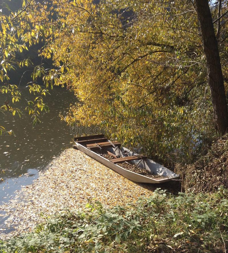 Autumn river and boat royalty free stock image
