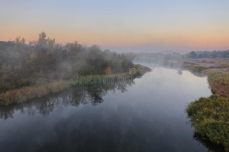 Autumn river. Cold morning landscape with a river. Grass covered by hoarfrost royalty free stock images