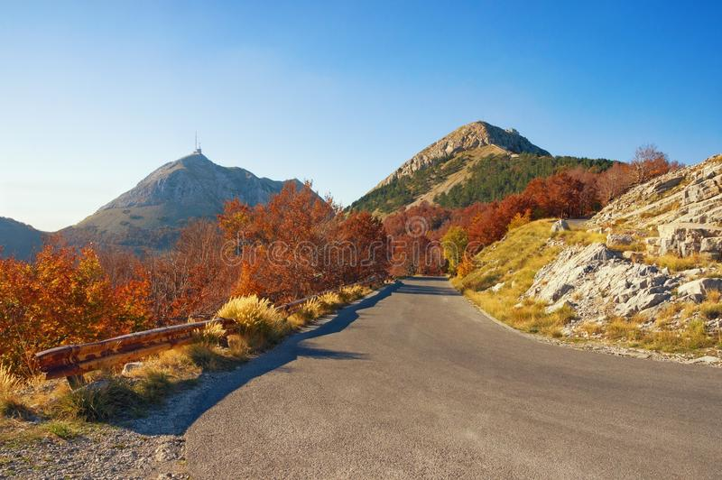 Autumn road in the mountains. Montenegro, Lovcen National Park stock images