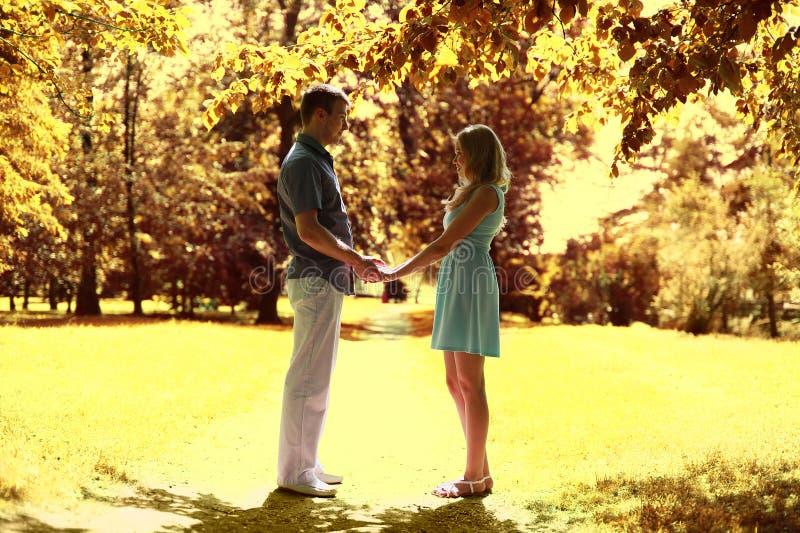 Autumn romance. Happy couple in love. Warm sunny day stock photography