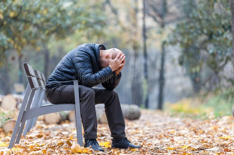 Autumn sadness and depression in the park. On the bench royalty free stock image