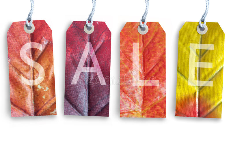 Autumn sale. Tags over a white background stock photos