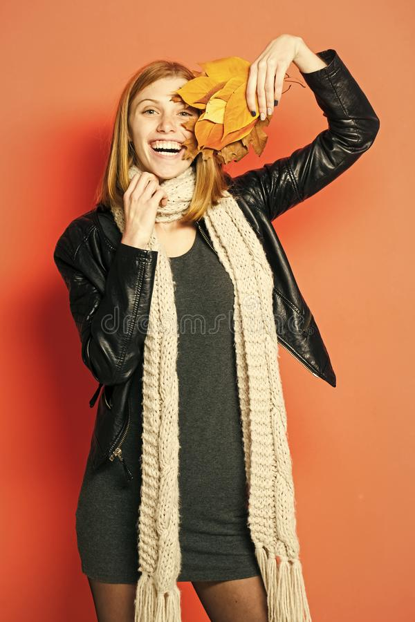 Autumn sale. Woman with autumn leaves in leather jacket. stock photos