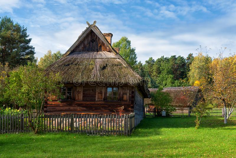 Rural farmstead ancient wooden house Rumsiskes Lithuania royalty free stock photography