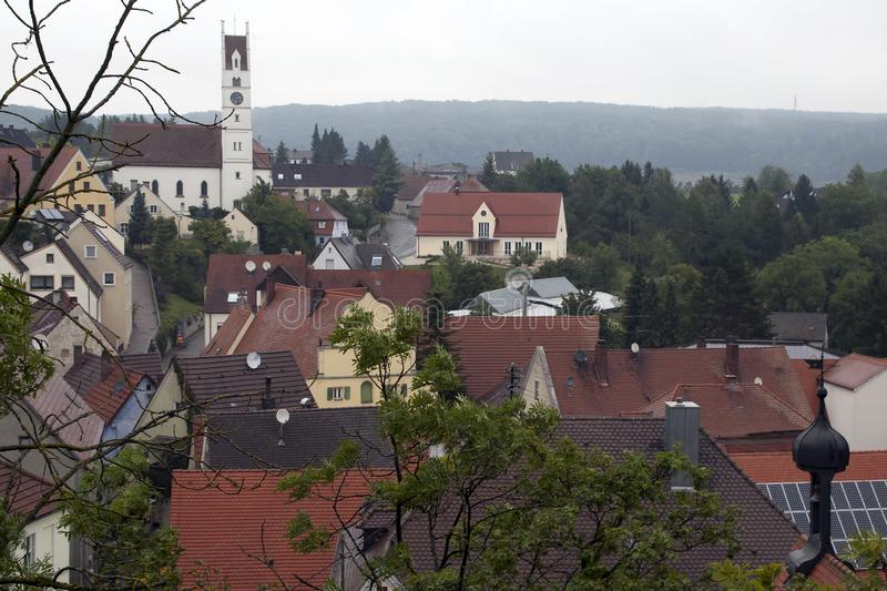 View over the village rooftops to the church royalty free stock photos
