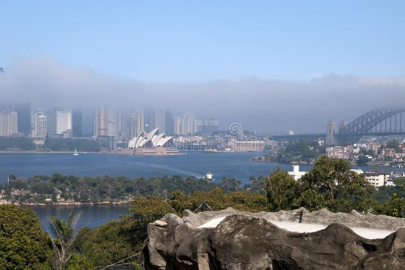 View of Sydney Harbour and Opera House with fog blanketing city royalty free stock photography