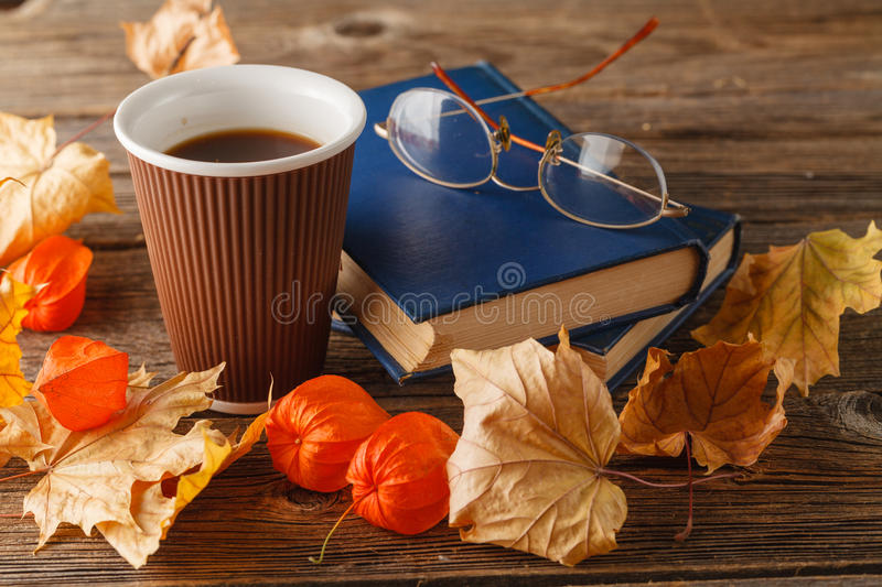 Autumn scene. Coffee cup and books stock photography
