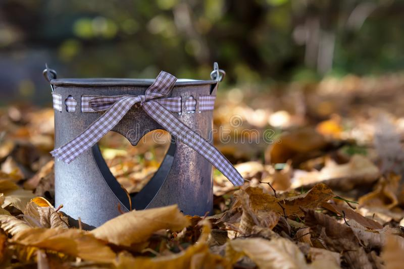 Autumn scene decoration in the forest with autumn leaves and Pots for flowers stock photos