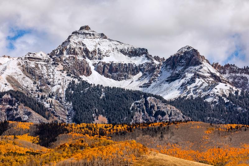 Autumn scene with snow and fall colors in the San Juan Mountains near Telluride, Colorado stock photography