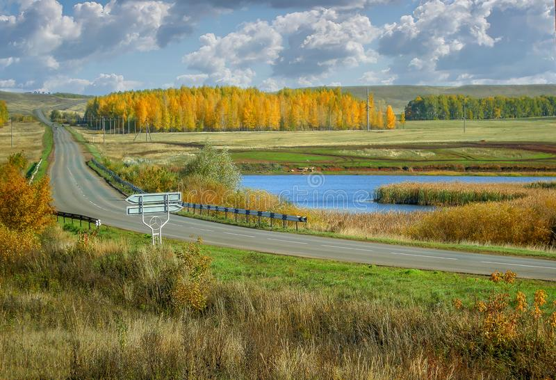 Autumn yellow birch forests and lake of Russia scenic landscape road in the valley stock image