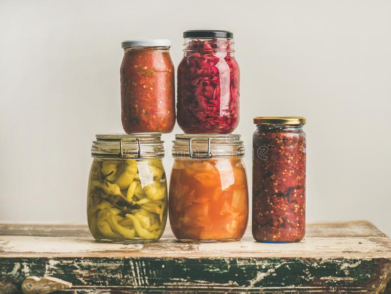 Autumn seasonal pickled or fermented colorful vegetables in glass jars royalty free stock photos