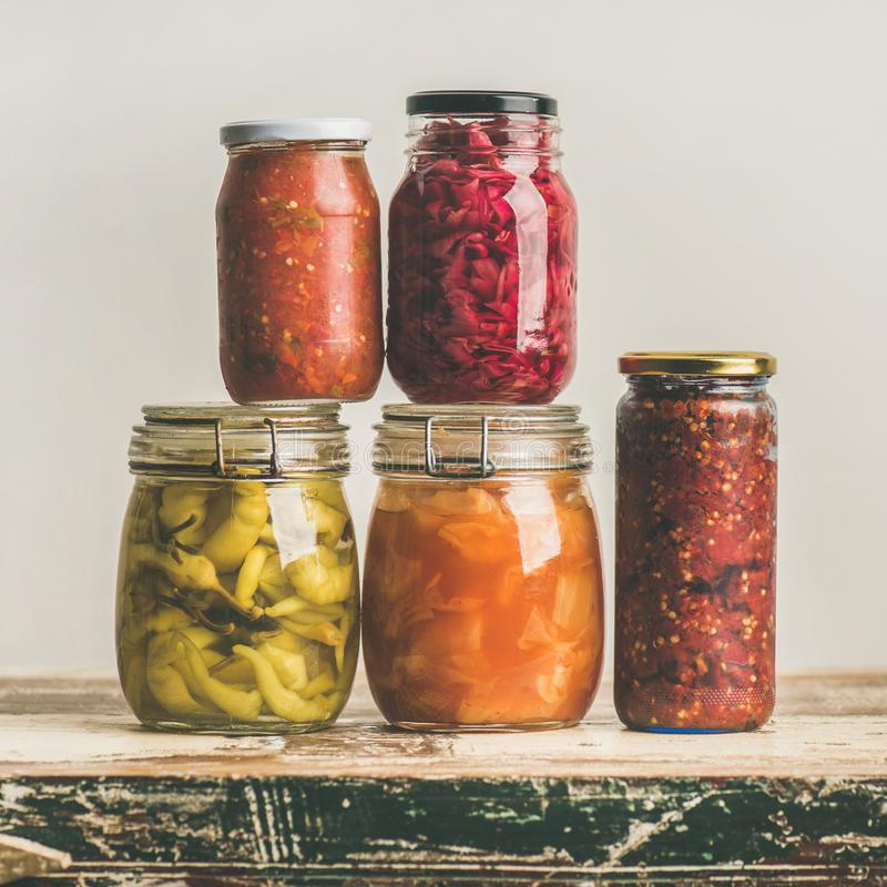 Autumn seasonal pickled or fermented vegetables in jars, square crop royalty free stock photos