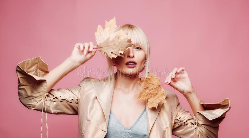 Autumn sensual blonde girl. Autumn Leaves Festival. Advertisement concept. Copy space for advertising. Promotional. Products. Autumn leaves. Logo for your stock photography