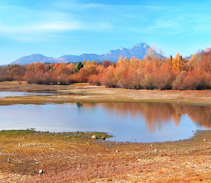 Autumn shore of Vah river at Liptovsky Trnovec, Slovakia royalty free stock photo