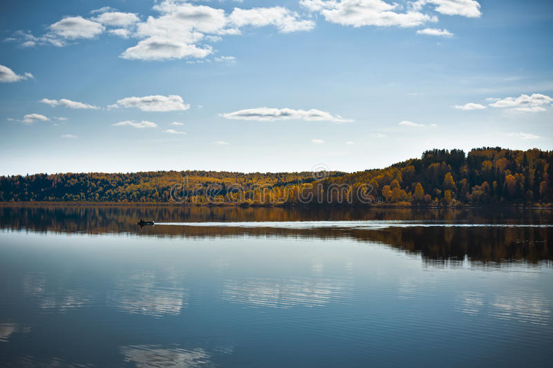 Download Autumn Shoreline With Beautiful Clouds Stock Photo - Image: 23162582