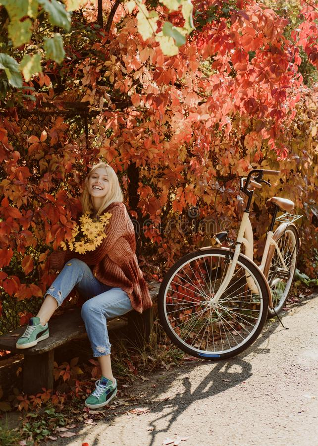 Autumn simple pleasures. Active leisure and lifestyle. Girl ride bicycle for fun. Blonde enjoy relax park. Autumn. Bouquet. Warm autumn. Girl with bicycle and royalty free stock images