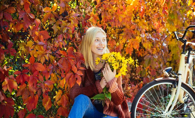 Autumn simple pleasures. Girl ride bicycle for fun. Blonde enjoy relax park. Autumn bouquet. Warm autumn. Girl with royalty free stock image