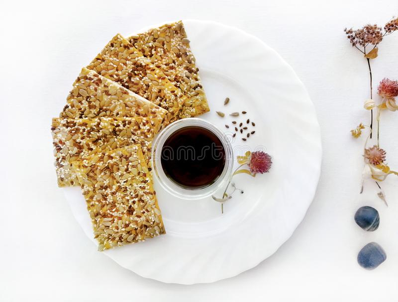 Autumn snack, a set of cookies with sesame seeds, cereal biscuits and black coffee royalty free stock image
