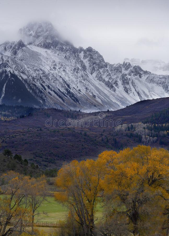 Autumn Snow. Fresh snow blankets the Rocky Mountains during fall foilage near Telluride, Colorado stock photo