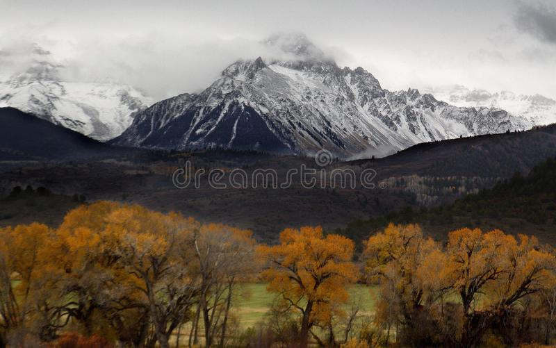 Autumn Snow. Fresh snow blankets the Rocky Mountains during fall foilage near Telluride, Colorado stock photos